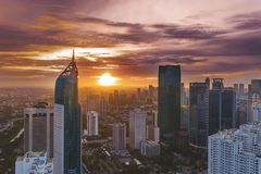 Beautiful sunrise over Jakarta office buildings. JAKARTA - Indonesia. January 02, 2019: Beautiful sunrise over Jakarta office buildings in Sudirman Central stock images