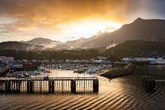 Beautiful Sunrise over the Marina in Skagway in Alaska, USA. Beautiful Sunrise over the Marina in the Small Harbor at the Port of Skagway in Alaska, USA royalty free stock photo