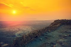 Beautiful sunrise over Masada fortress. Ruins of King Herod`s palace in Judaean Desert royalty free stock image