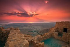 Beautiful sunrise over Masada fortress. Ruins of King Herod`s palace in Judaean Desert stock images