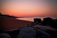 Beautiful sunrise over the Mediterranean Sea in Malgrat de Mar, Spain. Sunrise over the coast of Costa del Maresme. Rocks, beach, sea and sand at sunrise Stock Photography