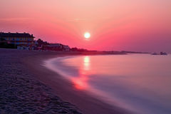 Beautiful sunrise over the Mediterranean Sea in Malgrat de Mar, Spain. Stock Photos