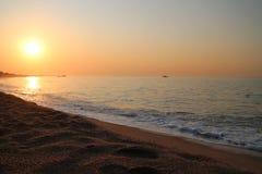 Beautiful sunrise over the Mediterranean Sea in Malgrat de Mar, Spain. Sunrise over the coast of Costa del Maresme. Rocks, beach, sea and sand at sunrise Royalty Free Stock Photo