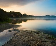 Beautiful sunrise over misty lake. Stock Photos