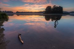 Beautiful sunrise over misty lake. Royalty Free Stock Images