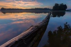 Beautiful sunrise over misty lake. Royalty Free Stock Photography