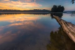 Beautiful sunrise over misty lake. Stock Image