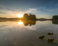 Beautiful sunrise over misty lake. Royalty Free Stock Image