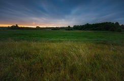 Beautiful sunrise over misty meadow Stock Photos