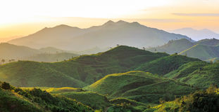 Beautiful sunrise over the mountain at the west oof Thailand. Beautiful sunrise over the mountain green hill at the west of thailand Royalty Free Stock Photography