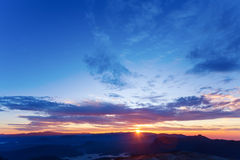 Beautiful sunrise over the mountains. Seen from Adam's Peak, Sri Lanka Royalty Free Stock Photography