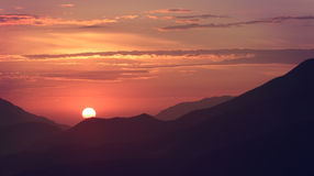 Beautiful sunrise over the mountains Stock Photo