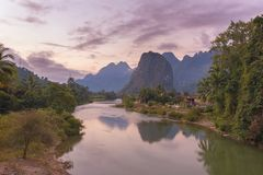 Beautiful sunrise over the Nam Song river near the Vang Vieng village. Laos Royalty Free Stock Images