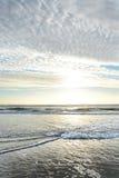 Beautiful sunrise over ocean horizon. Beautiful sunrise landscape, sun and clouds reflected in water. Jacksonville, Florida,USA Royalty Free Stock Photo