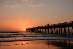 Beautiful sunrise over the ocean and pier. Royalty Free Stock Photography