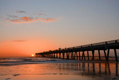 Beautiful sunrise over the ocean and pier. Stock Photography