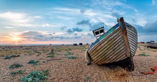 Beautiful Sunrise over an Old Wodden Boat Royalty Free Stock Image
