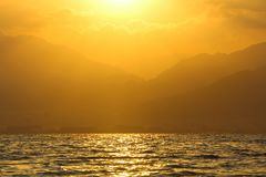 Golden sunrise over the Red sea. Beautiful Sunrise over the Red Sea and the bay of  Aqaba. Copy space, inspirational background Royalty Free Stock Images