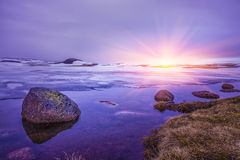 Beautiful sunrise over Rocks in a lake, Stock Images