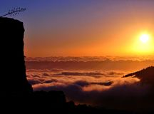 Beautiful sunrise over the sea of clouds Royalty Free Stock Image