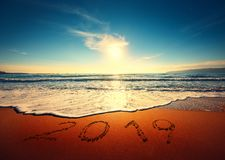 Beautiful sunrise over the sea. Happy New Year 2019 written on s royalty free stock photography