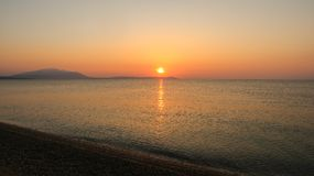 Beautiful Sunrise Over the Sea Nea Vrasna, Greece.  Stock Photos