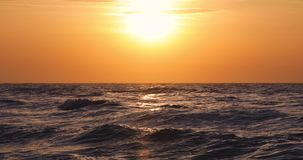 Beautiful sunrise over the sea and splashing waves on the beach. Video stock video