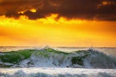 Beautiful sunrise over the splashing sea waves Royalty Free Stock Photography