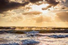 Beautiful sunrise over the splashing sea waves Royalty Free Stock Photo