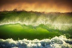 Beautiful sunrise over the splashing sea waves Stock Images