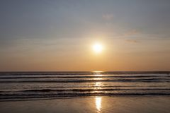 Beautiful sunrise over the tropical beach. In Bali Indonesia stock photos