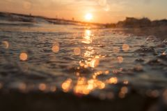 Beautiful sunrise over the tropical beach, blurred photo for background. Beach in sunset time, blurred photo for background stock photo