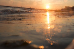 Beautiful sunrise over the tropical beach, blurred photo for background. Beach in sunset time, blurred photo for background stock photography