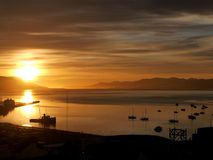 Sunrise at The Worlds End. A beautiful sunrise over Ushuaia harbour at The Worlds End Argentina Royalty Free Stock Photo