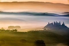 Beautiful sunrise over the valley of olive groves and vines royalty free stock image