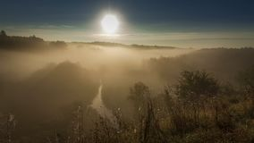 Beautiful sunrise over valley with stunning mist in autumn, timelapse. 4K stock footage