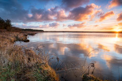 Beautiful Sunrise over Water. Stunning sunrise over Crowdy Lake a small reservoir on the edge of Bodmin Moor near Davidstow in Cornwall Royalty Free Stock Image