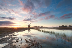 Beautiful sunrise over windmill and river Stock Photography