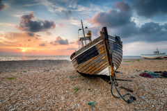 Beautiful Sunrise over Wooden Boat Royalty Free Stock Image