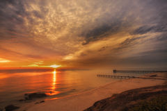 Beautiful sunrise. With pier at Samila beach Songkhla,Thailand Stock Images