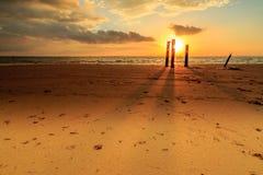 Beautiful sunrise and pole at Tanjung aru beach, Labuan. Malaysia. Tanjung Aru beach Labuan Malaysia. with beautiful sunrise Stock Photo
