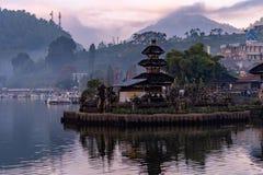 A beautiful sunrise at pura ulun danu bratan temple on Bratan lake, Bali, indonesia. ใ royalty free stock photos
