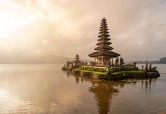 A beautiful sunrise at pura ulun danu bratan temple on Bratan lake, Bali, indonesia.  stock image