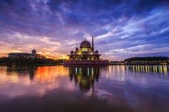 Beautiful sunrise at Putra Mosque, Putrajaya Malaysia. Colorful sunrise clouds and reflection at the lake surface Stock Image