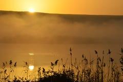 Beautiful sunrise and reflection in hagamon lake Royalty Free Stock Images