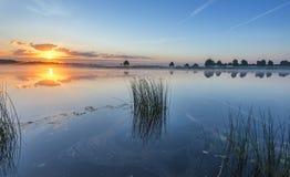 Beautiful sunrise at a river, Latvia, Europe Stock Images