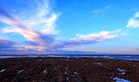 Beautiful sunrise on rocky shore and dramatic. Sky clouds stock photo