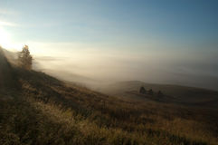 Beautiful sunrise in russian village. Foggy morning Stock Photography