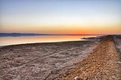 Beautiful sunrise on salt lake Chott el Djerid, Sahara desert, T Royalty Free Stock Images