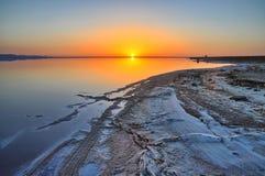 Beautiful sunrise on salt lake Chott el Djerid, Sahara desert, T Royalty Free Stock Photos
